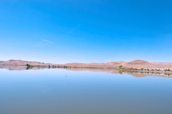Lahontan Reservoir with mountains in the background.
