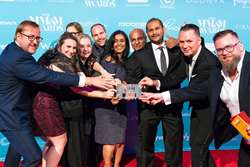 PIXACORE Team and the MM&M Mid-size Agency of the Year Trophy