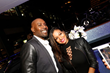 Actor Morris Chestnut and beauty expert, Milly Almodovar strike a pose onboard Utopia IV during the launch party for the new line of men's skin care, Lumiere de Vie Hommes.