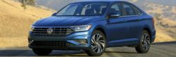 blue 2019 vw jetta on road