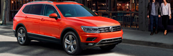 Orange 2019 Volkswagen Tiguan on city street