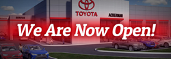 Ackerman Toyota dealership with the words we are now open overlaid on top