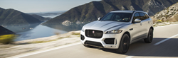 Silver 2019 Jaguar F-PACE Driving on a Coast Road