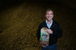 Don Thibodeau, President of Green Thumb Farms in Fryeburg, Maine, holds a new bag of Cold River Gold potatoes.
