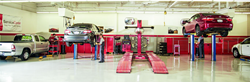 image of Toyota models being lifted and worked on in an official Toyota Service Center