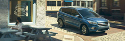 blue silver 2019 ford escape in city