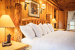 Plush goose down comforter-covered beds are in all rooms and cabins at Wyoming's secluded and exclusive Brooks Lake Lodge for a luxurious slumber.
