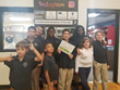 Cumberland Academy of Georgia's students hold up UNselfie contest message