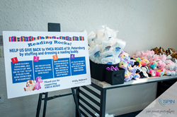 A charitable reception activity station by Wildly Different team building experiences.