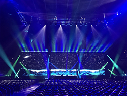 The event stage with three LED walls playing three 4k streams through the Christie Spyder X80