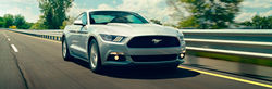 2017 Ford Mustang driving down the road