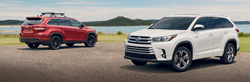 Two 2019 Toyota Highlander models on a beach.