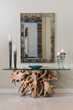 glass top console table, driftwood base, framed mirror