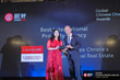 KS Koh of Landscope Christies accepts his award from Juwai CEO Carrie Law.