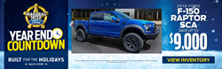 Blue 2018 Ford F-150 SCA Performance Raptor in Front of the Dealership with Blue Background, Marshal Mize Ford Sherrif Logo and White and Yellow Text Details
