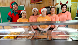 Cypress Bayou Casino Hotel's employees lined up behind a cafeteria-style food service bar and compassionately served hot meals to nearly 100 at St. Francis Diner.
