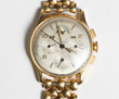 Lot #562, an 18k Gold Tri-Compax Universal Swiss Wristwatch, Estimated at $3,000-5,000.