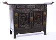 Lot #792, a Carved Chinese Zitan Wood Side Board, Estimated at $1,000-3,000.