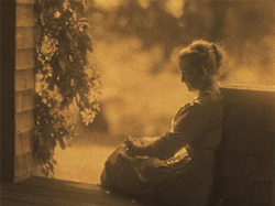 September sun by Dwight Davis circa 1910. Shows a woman sitting on a porch. Source: Library of Congress
