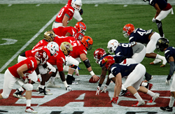 Game action featuring college all-star football players from across North America at the 94th East-West Shrine Game at Tropicana Field in St. Petersburg, FL.