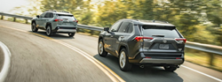 Two 2019 Toyota RAV4 models driving up highway ramp