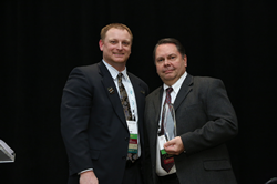 Photo of Roland DGA receiving the 2019 NADL Supplier of the Year Award.