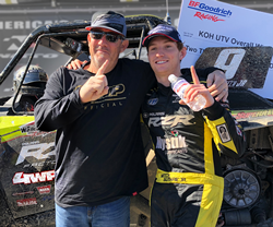 4 Wheel Parts' Mitch Guthrie Jr. wins second consecutive Can-Am UTV King of the Hammers title and poses with his father, six-time KOH champion Mitch Guthrie Sr.