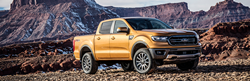 Orange 2019 Ford Ranger Front and Side Exterior in a Desert