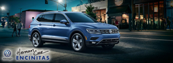 side view of a blue 2019 Volkswagen Tiguan with the Herman Cook VW logo