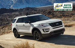 white Ford Explorer driving on off-road trail with Skook Auto Sales logo in corner