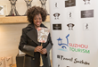 2017 Oscar winner Viola Davis learns about Suzhou and picks up a Sheng Feng fan at GBK Productions' Luxury Gifting Lounge held February 22 - 23 in Beverly Hills.