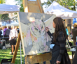 Local artist Amy Ringholz, a Jackson favorite, creates one of her signature wildlife paintings at the QuickDraw event during the Jackson Hole Fall Arts Festival.