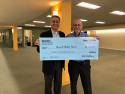 Sparo's Rob Sobhani (L) presents $15,000 check to Rabbi David Litwack (R) for Save A Child's Heart
