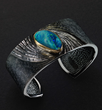 Alan Craxford, NewsCuff, silver, hand engraved and black rhodium plated, Australian Opal set in 22k gold.