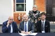 Representatives of Briovation, Health Innovation Manchester, and Manchester's Oxford Road Corridor sign the MOU Initiating an agreement to facilitate healthcare innovation in the UK and US.
