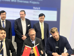 Co-Founder Aaron Wagener signing the agreement at the Hannover Messe