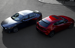 Overhead view of a gray 2019 Mazda3 Sedan parked next to a red 2019 Mazda3 Hatchback