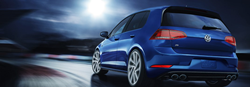 2019 Volkswagen Golf R driving down a dark road