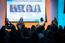 Diverse group of women speaking on stage at Ellevate Network's Mobilize Women Summit