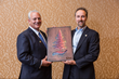 Quik! CEO Richard Walker presents a 2019 ReTree Award to Docupace CEO Mark Tapling