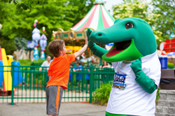 Child high fives Kyle the Crocodile, Lake Compounce's Mascot.