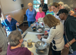 "Members of the City of Peekskill's Senior Nutrition Program try their hand at creating a health-supportive meal as part of the ""Cooking for Health"" program."