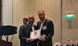 Level Access CEO Tim Springer accepting the Red Herring North America Top 100 Award from Red Herring Chairman Alex Vieux.