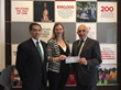 Savoy Foundation Board Chairman Carl J. Morelli (far left) and President Joseph Sciame Present Grant Check to Kirkley Strand of The New York Foundling for Camp Felix Program