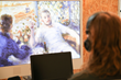 Test person in front of TV screen with calming ArtPlayer images and music in the headphones