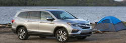 2018 Honda Pilot parked at a camp site near a lake