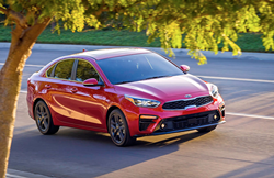 Red 2019 Kia Forte driving on highway