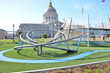 Award Wining Helen Diller Playground rises in front of San Franciso City Hall