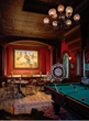 Kibler & Kirch helped create an in-home Wild West saloon featuring a curtained stage and Brunswick pool table for this special Wyoming home (photo by Audrey Hall).