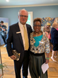 Roger Mumford (left) of Roger Mumford Homes, and Gilda Rogers, Vice President of the T. Thomas Fortune Foundation.